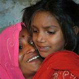 <p>Shimla Devi holds her daughter Pinki, who featured in an Oscar award-winning documentary, upon her arrival at her village Rampur Dhabahi, 50 km (31 miles) south of the northern Indian city of Varanasi, February 28, 2009. REUTERS/Pawan Kumar</p>