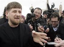 <p>Chechen President Ramzan Kadyrov (L) speaks with the media during their visit to the Chechen capital of Grozny February 19, 2008. REUTERS/Denis Sinyakov</p>