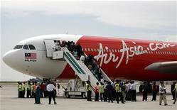 <p>The first leased long haul Malaysian AirAsia X's Airbus A330-300 sits on the tarmac during its inaugural ceremony at the airport in Sepang September 18, 2007. REUTERS/Bazuki Muhammad</p>