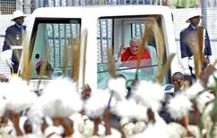 <p>Pope Benedict XVI waves at the crowd from his Popemobile as he arrives to lead a mass at Amadou Ahidjo stadium in Yaounde, March 19, 2009. REUTERS/Alessandro Bianchi</p>