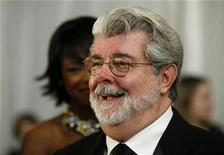<p>Filmmaker George Lucas speaks to reporters as he arrives for the Ford's Theater Grand Reopening Celebration in Washington February 11, 2009. REUTERS/Molly Riley</p>