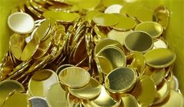<p>Austrian gold Vienna Philharmonic Bullion planchets are seen in the company's headquarters in Vienna March 11, 2009. REUTERS/Leonhard Foeger</p>