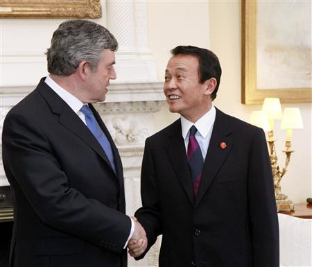 Britain's Prime Minister Gordon Brown greets his Japanese counterpart Taro Aso (R) inside 10 Downing Street in London April 1, 2009. World leaders will have their work cut out at a G20 summit where U.S. President Barack Obama makes his first major international sortie, under perhaps more pressure than anyone to show that the country where the crisis began can lead the way out. REUTERS/Olivier Hoslet/Pool