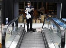 <p>A man looks at a list of employers during the 2009 CUNY Big Apple Job Fair at the Jacob K. Javits Convention Center in New York, March 20, 2009. REUTERS/Shannon Stapleton</p>