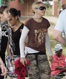 <p>Madonna in Malawi con la figlia Lourdes. REUTERS/Antony Njuguna</p>