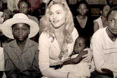 <p>Pop star Madonna holds the child named Mercy, whom she hopes to adopt, in this undated publicity photo taken in Malawi and released to Reuters April 13, 2009. REUTERS/Tom Munro/Warner Brothers Records/Handout</p>