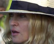 <p>U.S. pop singer Madonna looks on at a site where she is setting up a school near Lilongwe, March 29, 2009. REUTERS/Eldson Chagara</p>
