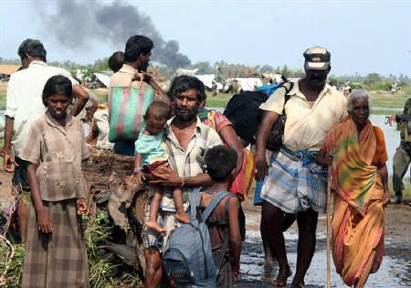 In this photograph released by the Sri Lankan military April 20, 2009 shows what the army says are thousands of people fleeing an area held controlled by the Tamil Tiger separatists in northeastern Sri Lanka. REUTERS/Sri Lankan Government/Handout