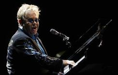 "<p>Britain's Elton John performs during his show called ""The Red Piano"" at La Bombonera stadium in Buenos Aires January 22, 2009. REUTERS/Marcos Brindicci</p>"