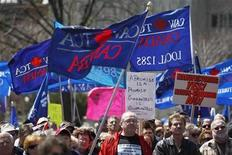 <p>Labour activists and union members gather at Queen's Park to advocate pension protections from government and corporations before Canadian Auto Workers (CAW) union President Ken Lewenza spoke in Toronto, April 23, 2009. REUTERS/Mark Blinch</p>