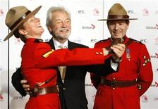 <p>Canadian actor Gordon Pinsent (C) dances with Royal Canadian Mounted Police Corporal Chrissie Lapointe (L) as Constable Alexander Young watches on the red carpet at the 29th annual Genie Awards in Ottawa April 4, 2009. REUTERS/Blair Gable</p>