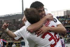 <p>Il milanista Kaka festeggia il gol segnato contro il Catania REUTERS/Antonino Condorelli</p>