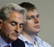 <p>Philip Markoff (R), a Boston University medical student, with his lawyer John Salsberg (L) at his side, is arraigned in Boston Municipal Court in Boston, Massachusetts in this recent photo from April 21, 2009. REUTERS/Mark Garfinkel/Pool</p>