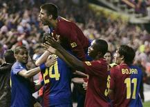 <p>Jogadores do Barcelona comemoram gol de Toure Yaya durante a vitória por 4 x 1 sobre o Athletic Bilbao na final da Copa do Rei no estádio Mestalla, em Valência, nesta quarta-feira. REUTERS/Heino Kalis</p>
