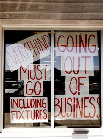 A sign hangs on a store going out of business in Arvada, Colorado February 28, 2009. REUTERS/Rick Wilking