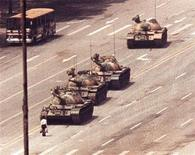 <p>A man stands in front of a convoy of tanks in the Avenue of Eternal Peace in Beijing, June 5, 1989. REUTERS/Arthur Tsang</p>