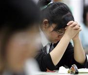 <p>A South Korean student prays before taking her College Scholastic Ability Test in a file photo. REUTERS/Lee Jae-Won</p>