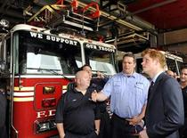 <p>Britain's Prince Harry (R) speaks with Captain Joseph McHugh (C) and firefighter Anthony Henry, both of the New York City Fire Department's Ladder 10/Engine 10, after visiting the site of the September 11, 2001 attacks on the World Trade Center in New York City, May 29, 2009. REUTERS/Stephen Chernin/Pool</p>