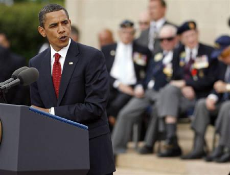 U.S. President Barack Obama addresses attendees of the 65th anniversary of the allied landings at the U.S. war cemetery at Colleville-sur-Mer June 6, 2009.  REUTERS/Mal Langsdon