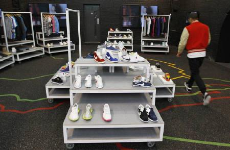 A member of staff walks inside the temporary Nike store in Shoreditch, East London in this April 30, 2009 file photo. REUTERS/Stephen Hird