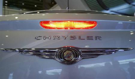 A Chrysler logo is seen on the trunk of a Sebring type car during the annual shareholder meeting of DaimlerChrysler in Berlin April 4, 2007. REUTERS/Arnd Wiegmann