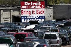 """<p>A large """"Buy American"""" sign, in support of Detroit's auto industry, is seen in the back of an auto scrap yard in Detroit, Michigan May 18, 2009. REUTERS/Rebecca Cook</p>"""