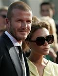 <p>Jogador de futebol David Beckham e sua esposa Victoria em Los Angeles. 16/07/2008. REUTERS/Danny Moloshok</p>
