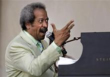 <p>Musician and songwriter Allen Toussaint performs at the New Orleans Jazz and Heritage Festival in New Orleans, Louisiana May 6, 2007. REUTERS/Lee Celano</p>