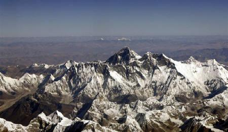 Mount Everest, the highest peak in the world, with an altitude of 8,848 meters (29,028 feet), is seen in this aerial view taken from a passenger aircraft flying over Nepal at a height of 9,144 meters (30,000 feet) in this November 9, 2008 file photo. REUTERS/Desmond Boylan/Files
