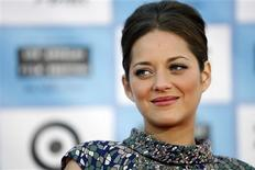 "<p>Cast member Marion Cotillard poses at the premiere of the movie ""Public Enemies"" at Mann Village theatre in Westwood, California June 23, 2009. The movie opens in the U.S. July 1. REUTERS/Mario Anzuoni</p>"