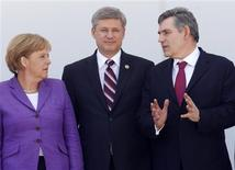 <p>Canada's Prime Minister Stephen Harper (C) stands with Germany's Chancellor Angela Merkel and British Prime Minister Gordon Brown during a family photo at the G8 summit in L'Aquila, Italy July 10, 2009. REUTERS/Chris Wattie</p>