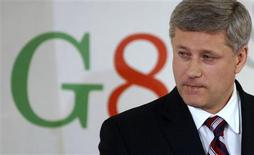 <p>Canada's Prime Minister Stephen Harper pauses during a news conference at the end of the G8 summit in L'Aquila, Italy July 10, 2009. After two days of talks focused on the economic crisis, trade and global warming, the final day of the G8 gathering in Italy looked at the problems facing the poorest nations. REUTERS/Chris Wattie</p>