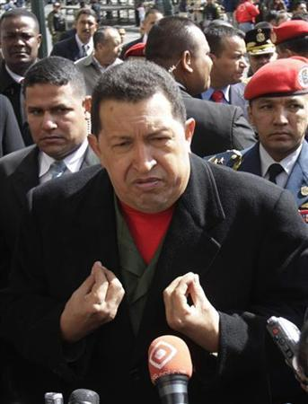 Venezuela's President Hugo Chavez speaks to journalists at the entrance of the Bolivian presidential palace in La Paz, July 17, 2009. Venezuela rejected on Tuesday a U.S. government report that said it was not cooperating fully in the war on drug trafficking, saying such accusations had to stop if bilateral relations were to improve. REUTERS/Gaston Brito