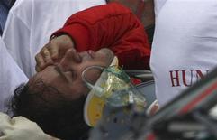 <p>Felipe Massa, ao ser levado ao hospital após acidente no sábado, foi retirado de coma induzido e respira sem aparelhos. REUTERS/ Stringer</p>