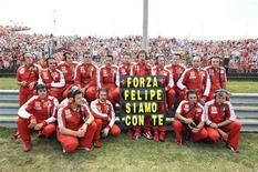 <p>Il team Ferrari. REUTERS/Stringer (HUNGARY SPORT MOTOR RACING)</p>