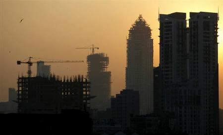 Buildings under construction are seen under the Mumbai skyline in this November 2008 file photo. REUTERS/Arko Datta