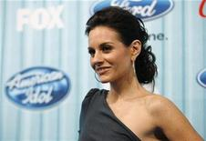 "<p>American Idol judge Kara DioGuardi poses at the party for the 12 finalists of the television show ""American Idol"" in Los Angeles March 5, 2009. REUTERS/Mario Anzuoni</p>"