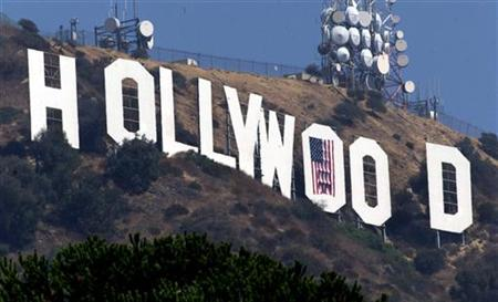 An American flag is positioned over the letter O in the famed Hollywood sign in the Hollywood Hills in this September 21, 2001 file photo.