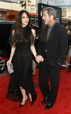 Actor Mel Gibson and actress Oksana Grigorieva arrive at an industry screening of ''X-Men Origins: Wolverine'' at the Grauman's Chinese theatre in Hollywood, California April 28, 2009.  REUTERS/Mario Anzuoni/Files