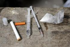 <p>A bag of heroin and drug paraphernalia are seen at an abandoned house in Ljubljana, Slovenia, August 3, 2009. REUTERS/Bor Slana</p>