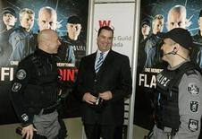 """<p>James Moore, Minister of Canadian Heritage and Official Languages, laughs with actors Hugh Dillon and Enrico Colantoni on the set of their television series """"Flashpoint"""" where Moore announced the creation of the Canadian Media Fund during a news conference in Toronto March, 9, 2009. REUTERS/ Mike Cassese</p>"""