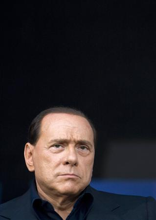 Italy's Prime Minister Silvio Berlusconi looks on during a meeting in Rome, September 11, 2008. REUTERS/Tony Gentile