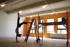 """<p>Yoga instructor Emily Conradson does a handstand in the expanded studio space at """"Om Factory"""" yoga studio in New York, in this picture taken August 7, 2009. REUTERS/Jamie Fine</p>"""