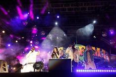 <p>(L to R) Apl.de.ap, Fergie, will.i.am and Taboo of U.S. hip-hop group The Black Eyed Peas perform during the Isle of MTV concert in Floriana, outside Valletta, July 8, 2009. REUTERS/Darrin Zammit Lupi</p>