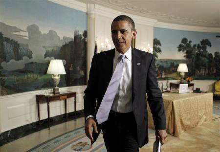 9月6日、アクセルロッド大統領上級顧問とギブズ大統領報道官は、公的保険制度を導入する案を依然としてオバマ大統領(写真)が支持しているとしながらも、妥協する可能性があることを示唆した。先月、ホワイハウスで撮影(2009年 ロイター/Jim Young)