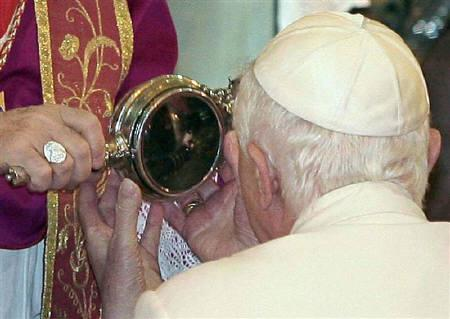 Pope Benedict XVI views what local Roman Catholics believe is the blood of Saint Gennaro, during a visit to the Duomo in Naples in this October 21, 2007 file photo. REUTERS/Ciro Fusco/Pool/Files