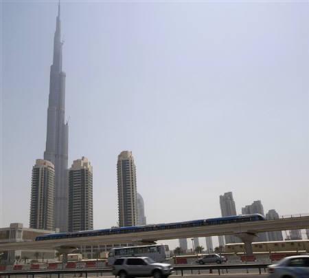 Metro Dubai train runs on its first working day in Dubai September 10, 2009. REUTERS/Ahmed Jadallah