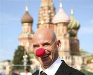 <p>Canadian billionaire Guy Laliberte smiles as he poses in Red Square in Moscow September 10, 2009. REUTERS/Sergei Remezov</p>