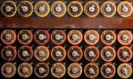 <p>A British Turing Bombe machine is seen functioning in Bletchley Park Museum in Bletchley, central England, September 6, 2006. For the first time in sixty years Bletchley Park re-created the way the 'unbreakable' Enigma code was broken using functioning World War Two equipment. The Bombe was the brainchild of mathematical geniuses Alan Turing and Gordon Welchman, and enabled Bletchley Park's Cryptographers to decode over 3000 enemy messages a day breaking the codes created by German military Enigma machine during World War Two. REUTERS/Alessia Pierdomenico</p>