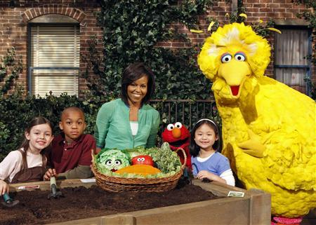 First Lady Michelle Obama is shown in this undated publicity photograph as she plants a garden on ''Sesame Street'' with characters Big Bird and Elmo. ''Sesame Street'', the world's largest informal children's educator, celebrates its 40th birthday on November 10, 2009 with Obama's appearance on the show. REUTERS/Richard Termine/Handout